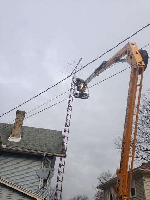 Barnes Wildlife Control used their lift to raise right up over the top of the two-story home to take down and apart the tower, and to repair where it had impacted the side of the house.