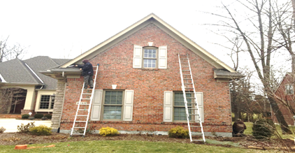 Barnes Wildlife Control's Bat Bug Removal Service techs sealing a Beavercreek home for bats.